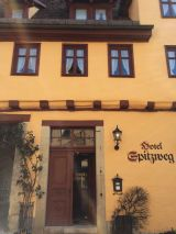 Hotel Spitzweg. Our charming hotel in Rothenburg is a renovated mansion built in 1536. We were ushered in by a gaunt Santa Claus named Walder, who, after asking if we were spies, insisted we all (save pregnant Heather) take a shot of moonshine.
